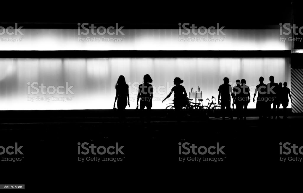Silhouettes of young people in the night stock photo