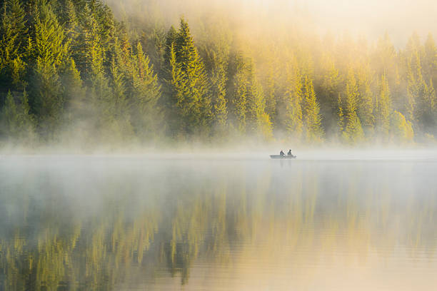 XXXL: Silhoutte of two men  fishing in the early morning. stock photo