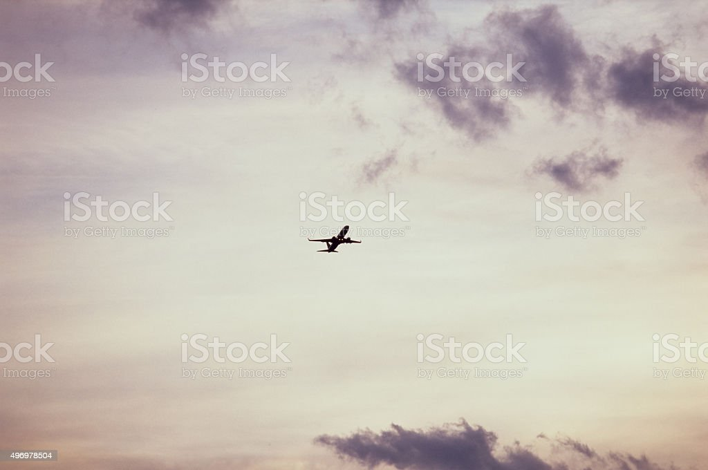 Silhuette of an airliner taking off at the sunset stock photo