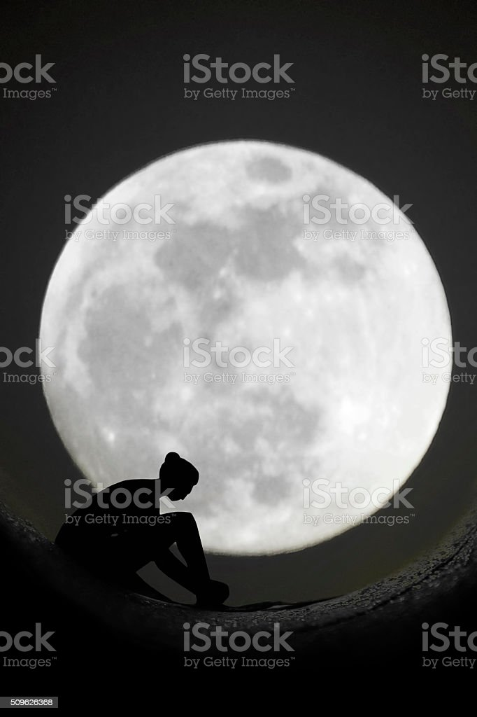 silhuette of ballerina with full moon in background stock photo