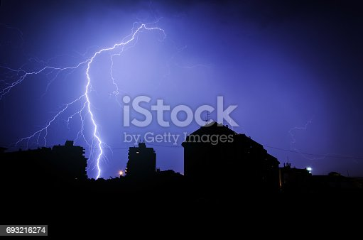 istock Silhuette of Thunderbolt over the buildings 693216274