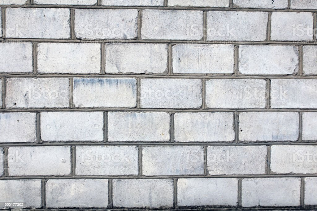 silicate white brick wall with grey gray seams stock photo