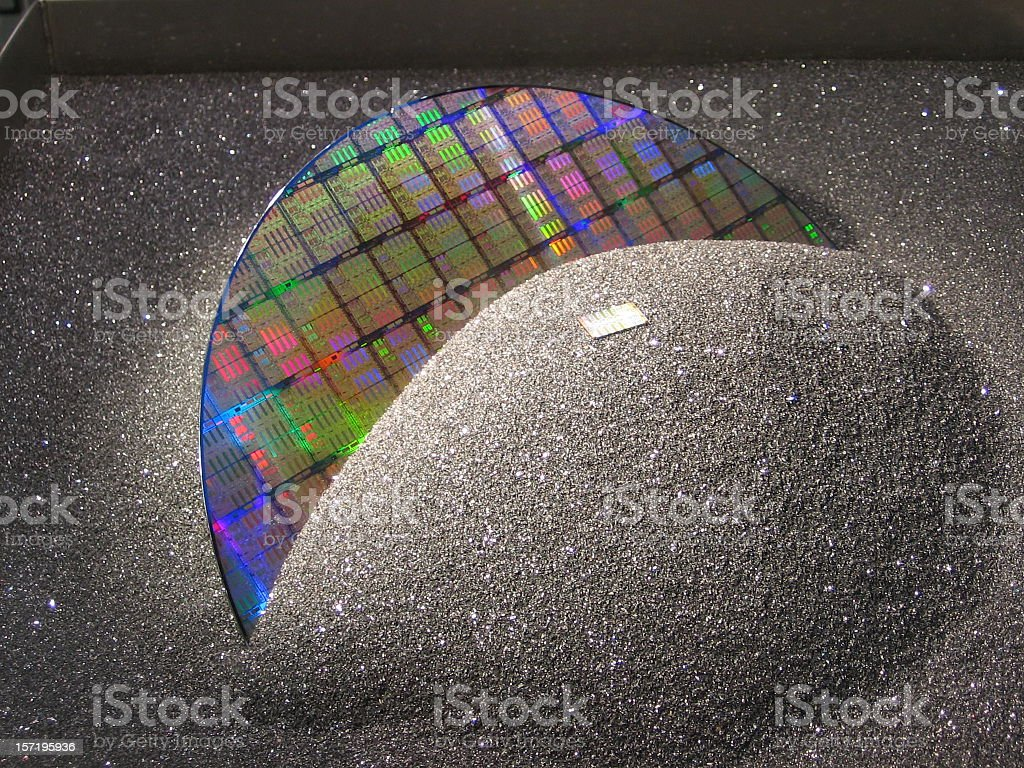 A silicon wafer covered with black sand stock photo
