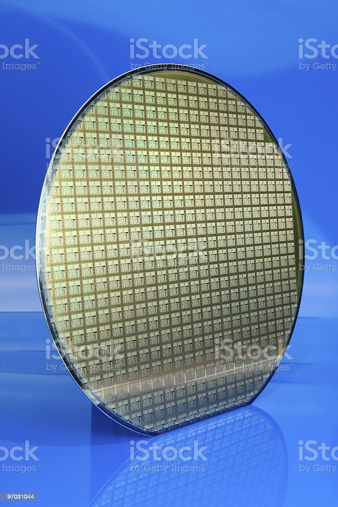 Silicon wafer on blue background stock photo