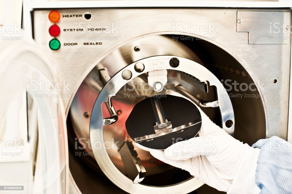 Silicon Wafer Under Cleanroom Fabrication & Testing stock photo