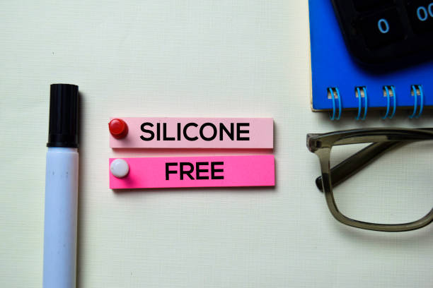 Silicone Free text on sticky notes isolated on office desk Silicone Free text on sticky notes isolated on office desk cobalt sulfate stock pictures, royalty-free photos & images