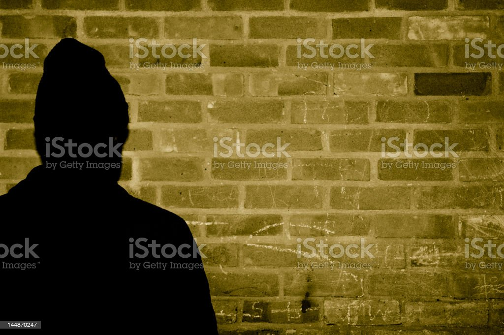 siliouhete of young man next to wall royalty-free stock photo