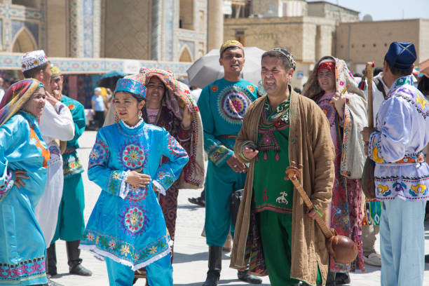 Silk and Spices Festival 2018. Bukharian musicians in local dress dance, in Bukhara, Uzbekistan. BUKHARA, UZBEKISTAN - MAY 25, 2018: Silk and Spices Festival 2018. Bukharian musicians in local dress dance, in Bukhara, Uzbekistan muziekfestival stock pictures, royalty-free photos & images