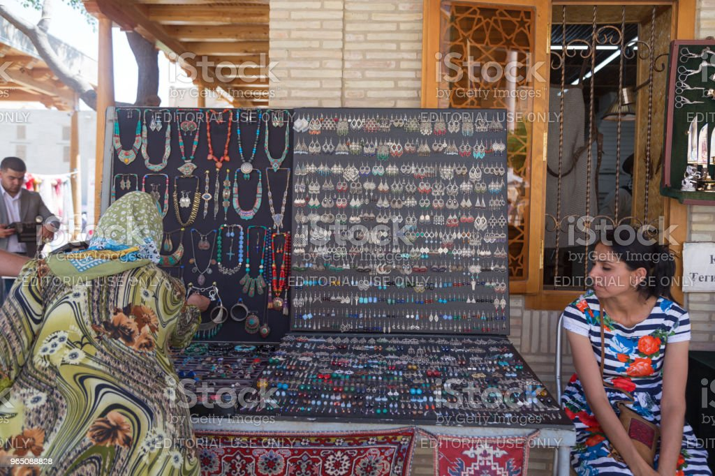 BUKHARA, UZBEKISTAN - MAY 25, 2018: Silk and Spices Festival 2018. Colorful traditional uzbek ancient handcraft jewellery in the bazaar in Bukhara, Uzbekistan. royalty-free stock photo