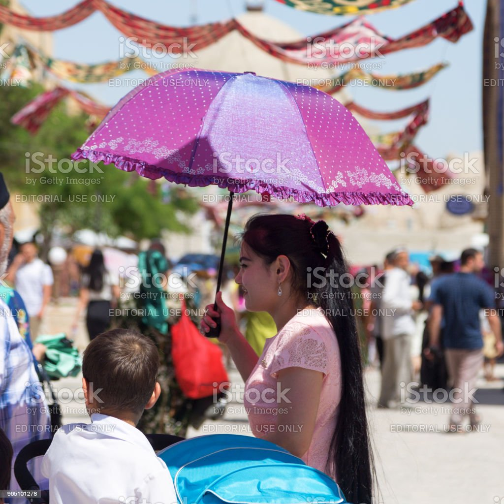 BUKHARA, UZBEKISTAN - MAY 25, 2018: Silk and Spices Festival 2018. People at festival in Bukhara, Uzbekistan. royalty-free stock photo