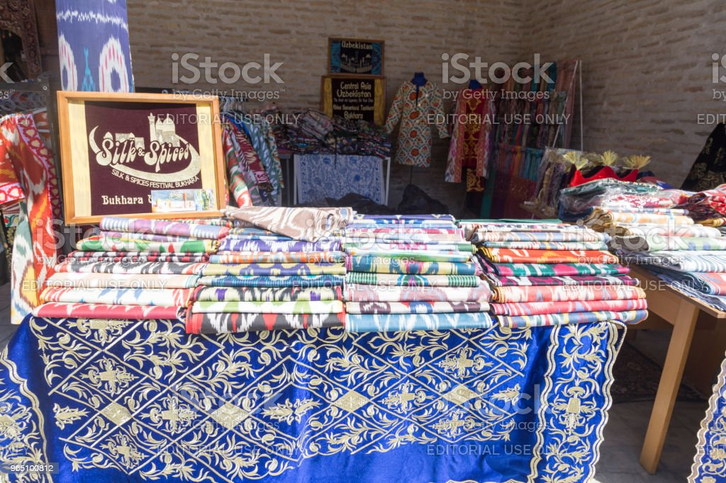 BUKHARA, UZBEKISTAN - MAY 25, 2018: Silk and Spices Festival 2018. Traditional Uzbek asian silk fabric shop in Bukhara, Uzbekistan. royalty-free stock photo