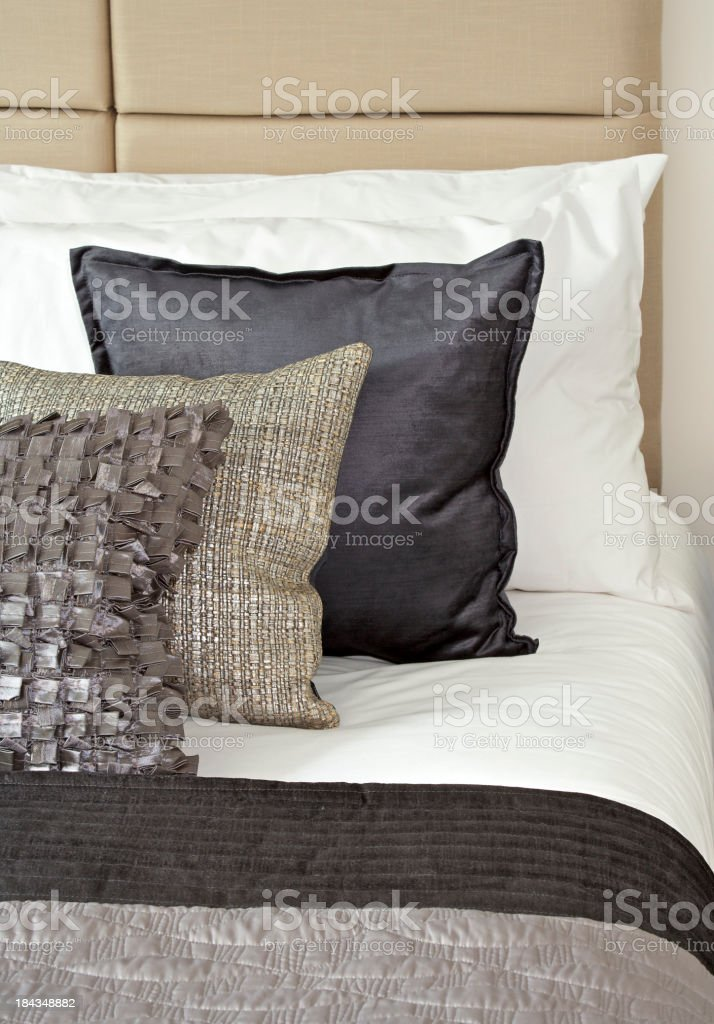 silk cushions and white sheets royalty-free stock photo