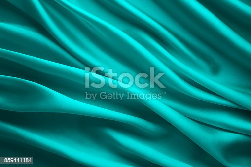 istock Silk Fabric Background, Blue Satin Cloth Waves, Abstract Flowing Waving Textile 859441184