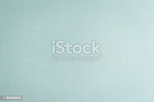 Silk fabric wallpaper texture pattern background in light pale blue green teal color tone