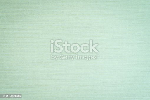 859441184 istock photo Silk fabric wallpaper texture pattern background in light pale blue green teal color 1251043636