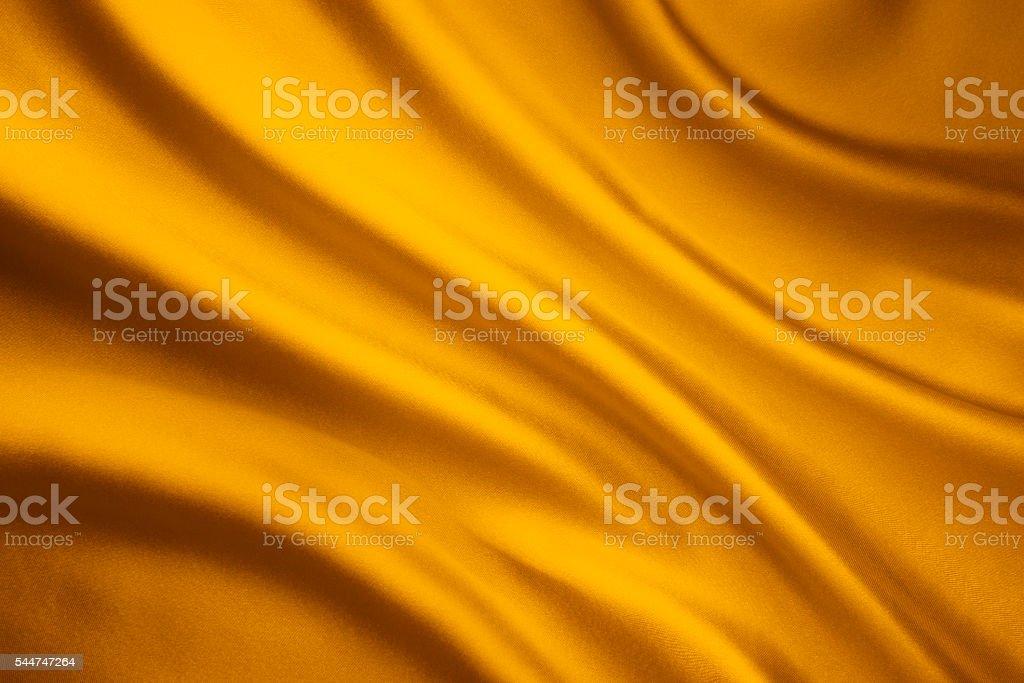 Silk Fabric Wave Background, Yellow Satin Cloth Texture stock photo