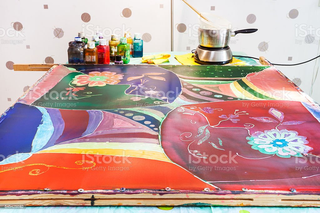 silk fabric with final fourth layer of paints stock photo