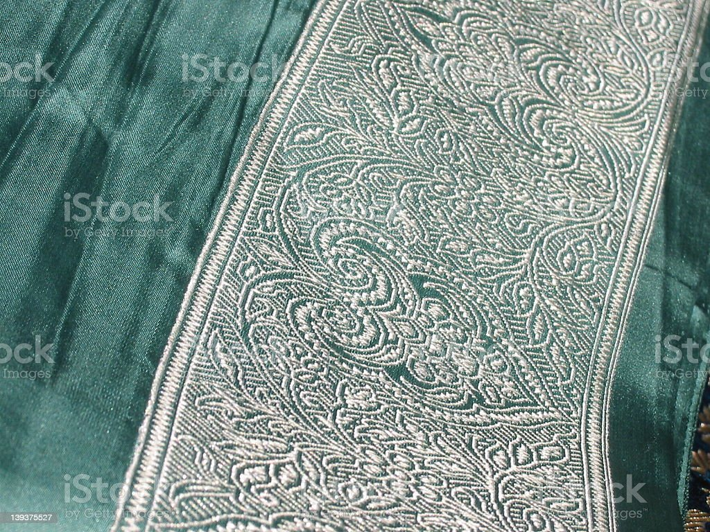 silk sari border, white embroidered pattern on green royalty-free stock photo