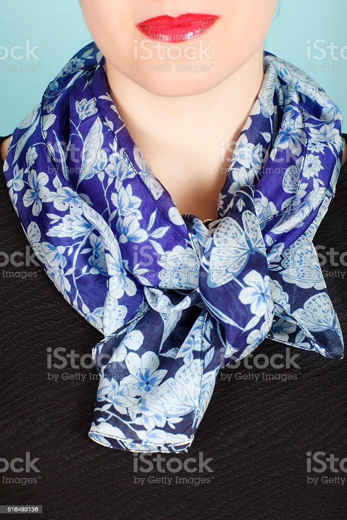 Silk scarf. Blue silk scarf around her neck isolated on white background. stock photo