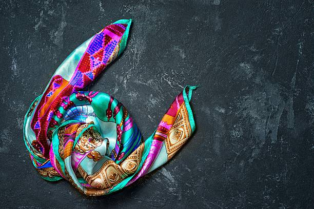 Silk scarf on a black background Silk scarf on a black background headscarf stock pictures, royalty-free photos & images