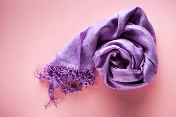 silk scarf on a pink background, top view - lenço do pescoço imagens e fotografias de stock