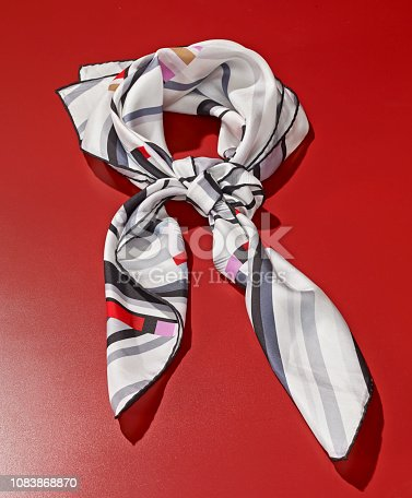 Silk scarf on red background