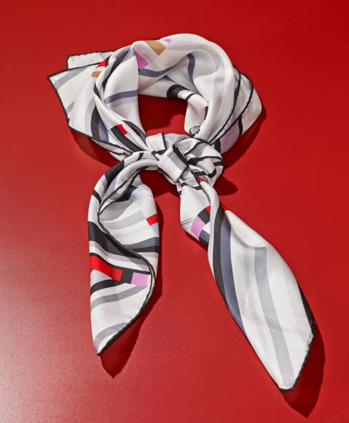 Silk scarf Silk scarf on red background headscarf stock pictures, royalty-free photos & images