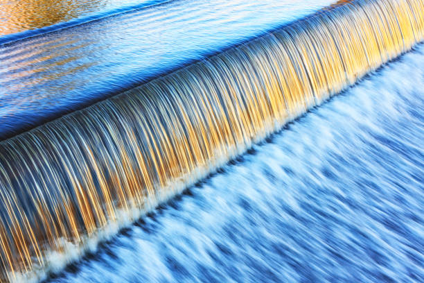 silky golden light on lake placid new york evening waterfall - энергия воды стоковые фото и изображения