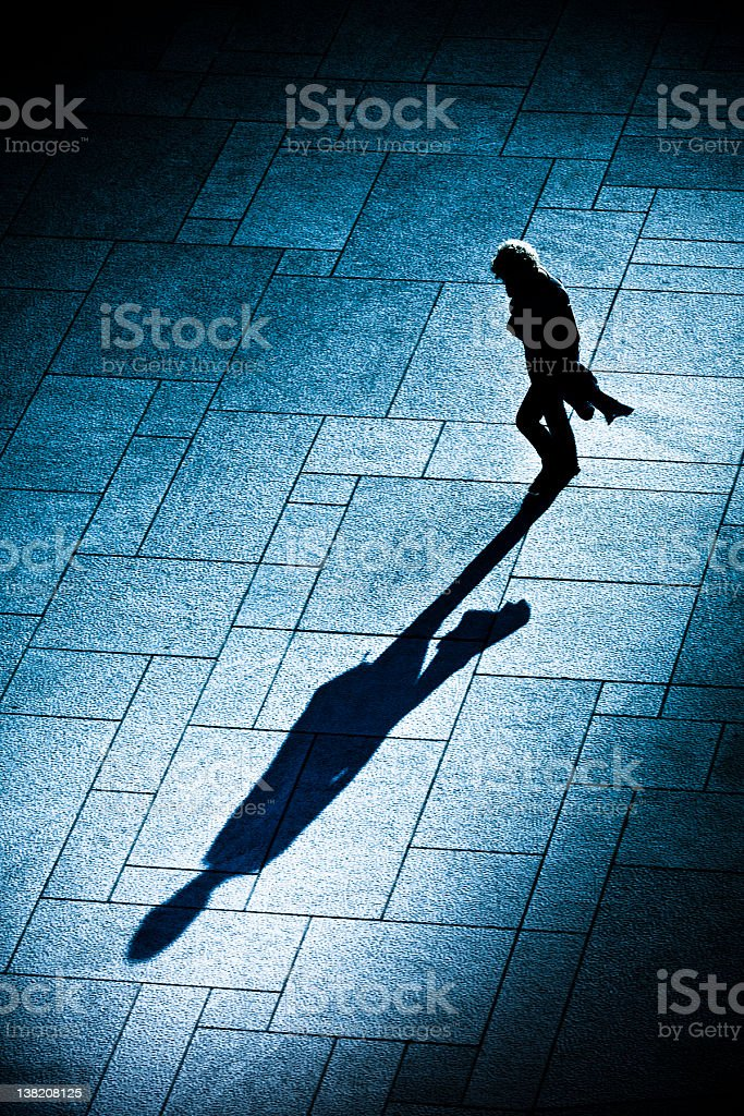 Sillhouette of woman walking at sunset royalty-free stock photo