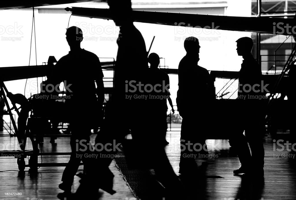 Sillouette of Men In a Factory royalty-free stock photo