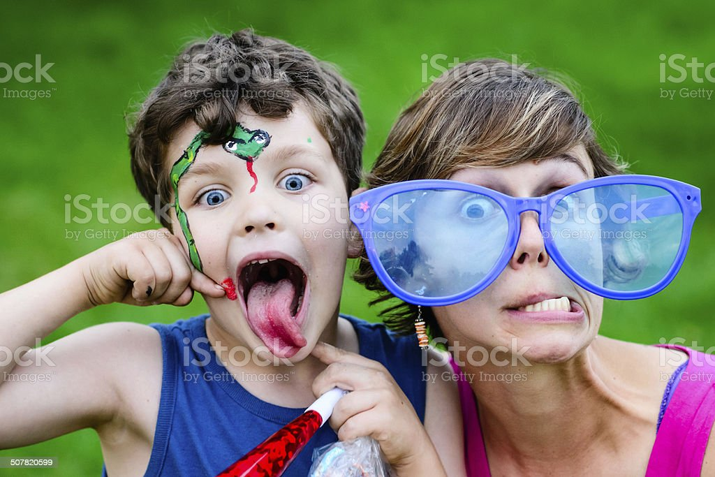 Silly Boy and Mom at Carnival stock photo