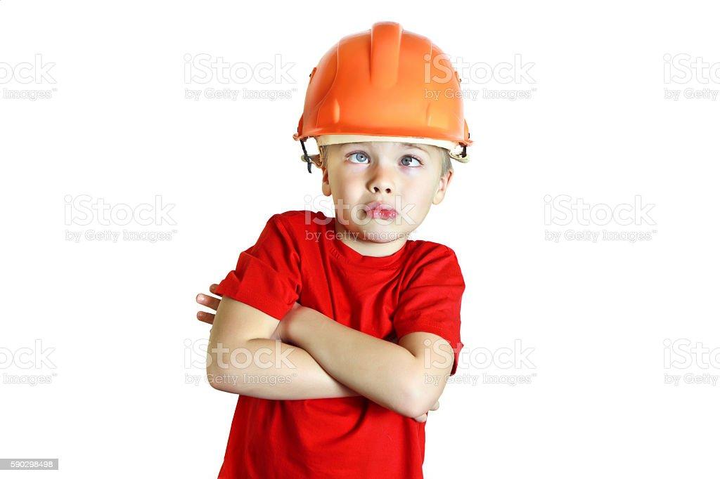 Silly boy in the construction helmet royaltyfri bildbanksbilder