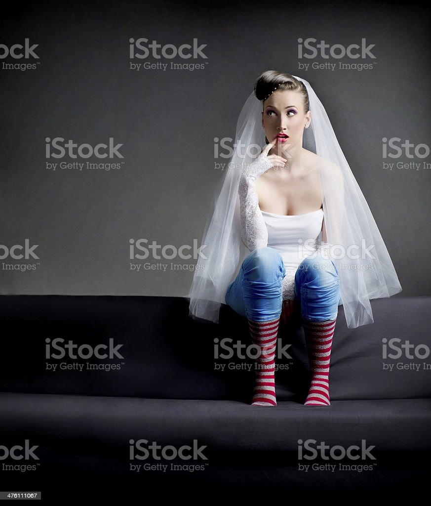 silly bride with striped socks stock photo