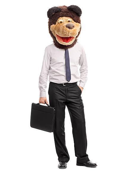 silly homme d'affaires portant un masque childish bear - mascotte photos et images de collection