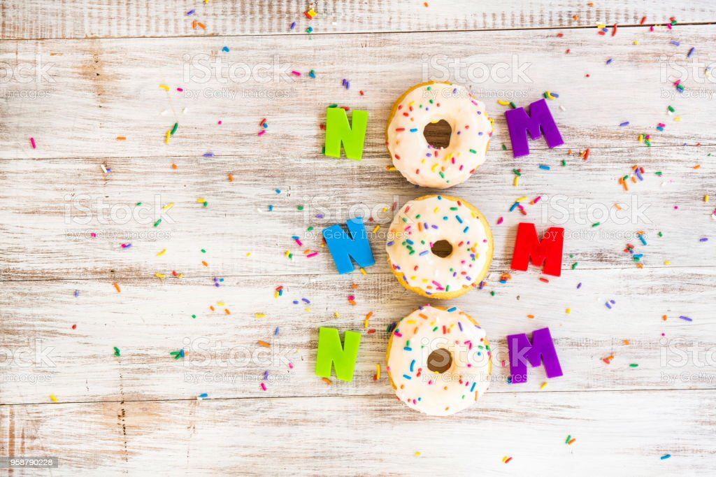 Silly Donut Saying On White Board With Sprinkles Concept stock photo