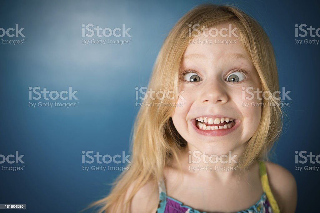 Silly, Five Year Old Blond-Haired Girl Making Face stock photo