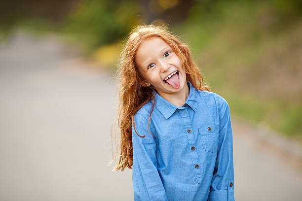 silly little red-haired girl - sticking out tongue stock photos and pictures