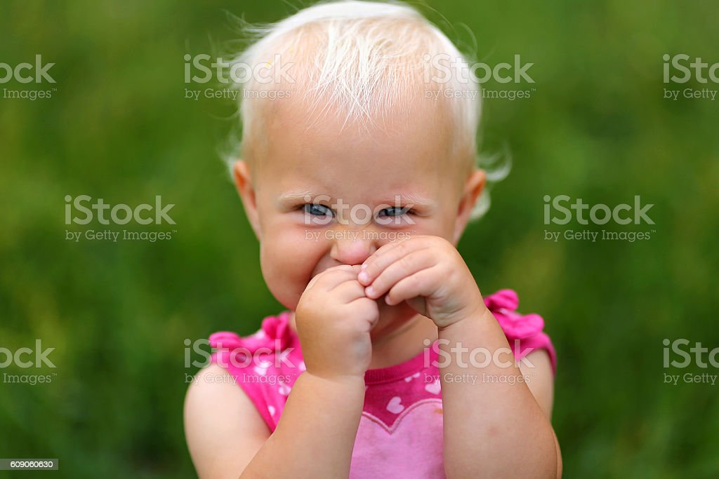 Silly One Year Old Baby Girl Being Cute stock photo