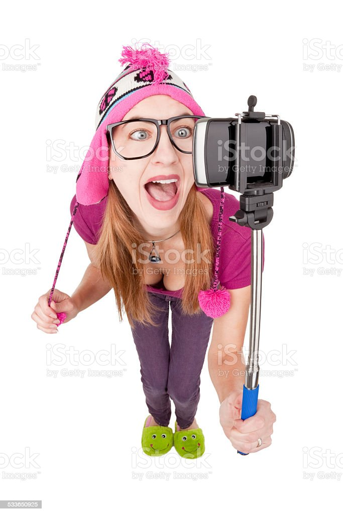 Silly Woman Using A Selfie Stick stock photo