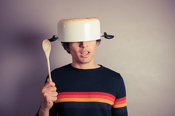 Silly young man with pot on his head stock photo