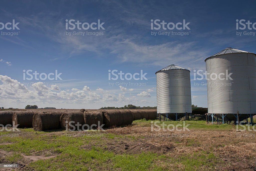 Silo and hay bale with big sky royalty-free stock photo