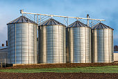 Silo in beautiful landscape with dramatical light placed in plouged acres