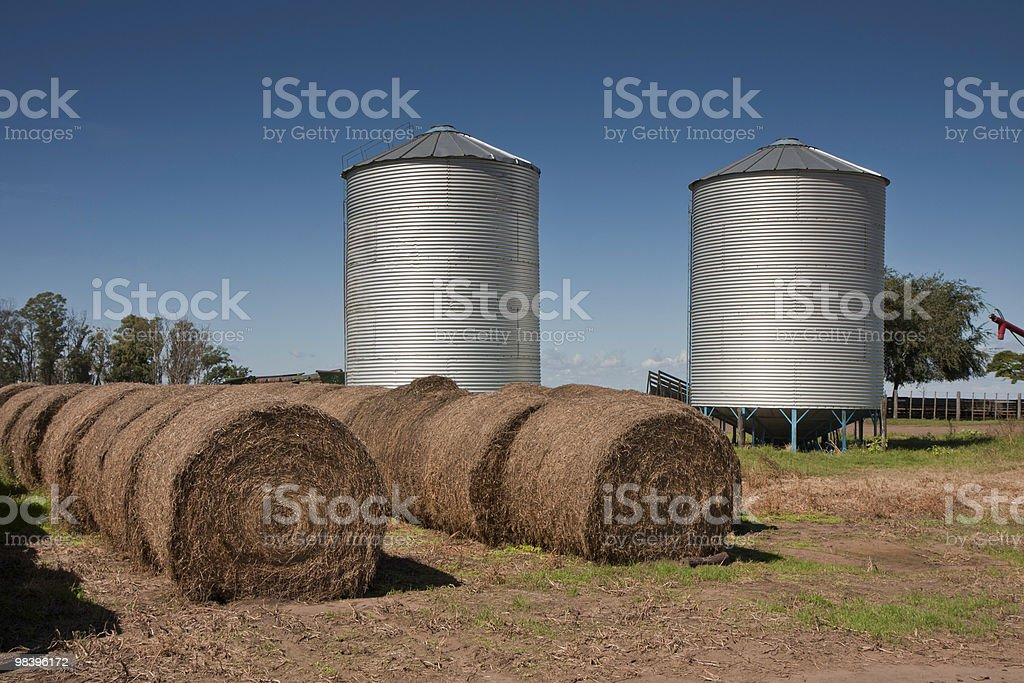 silos and hay bales royalty-free stock photo