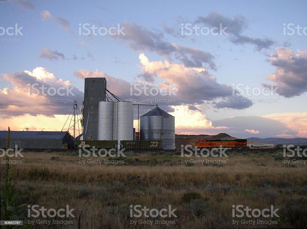 silos & train at sunset royalty-free stock photo