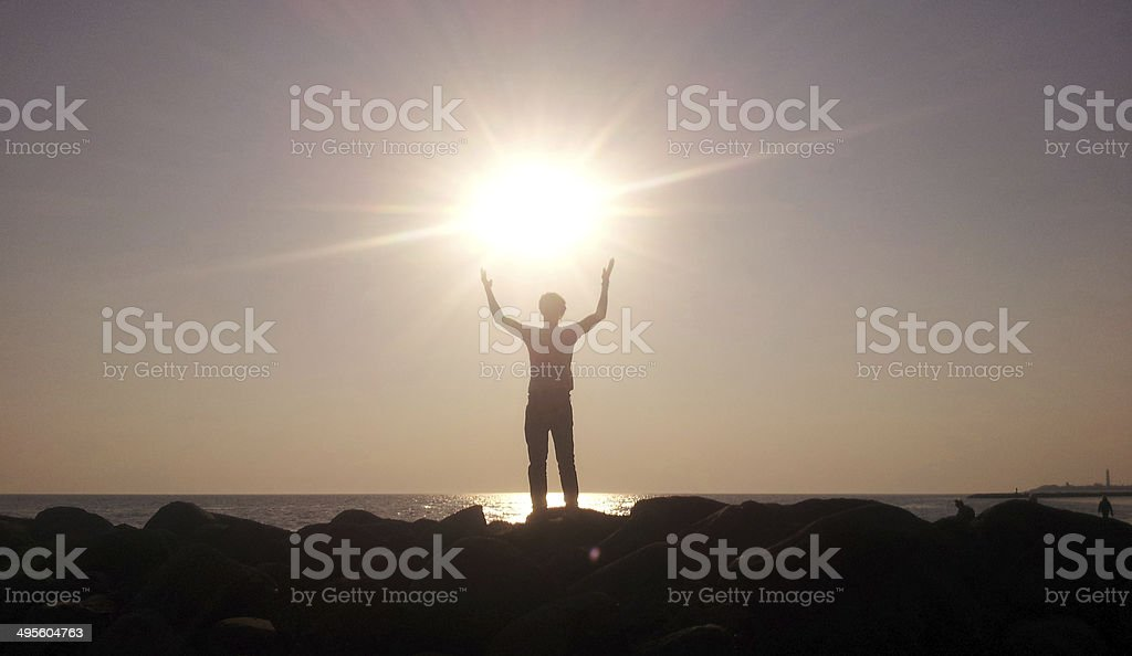 Silouette of a man embraces the sun royalty-free stock photo