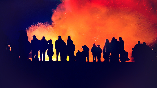 Silouette of people at the traditional Easter bonfire