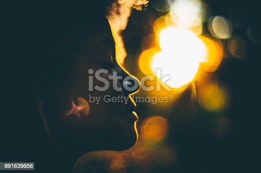 istock Silouette of young curly girl during sunset 691639656