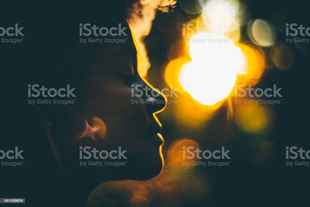 Silouette of young curly girl during sunset stock photo
