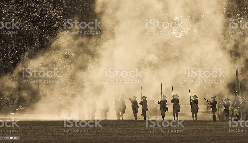 silouettes in cannon smoke II stock photo