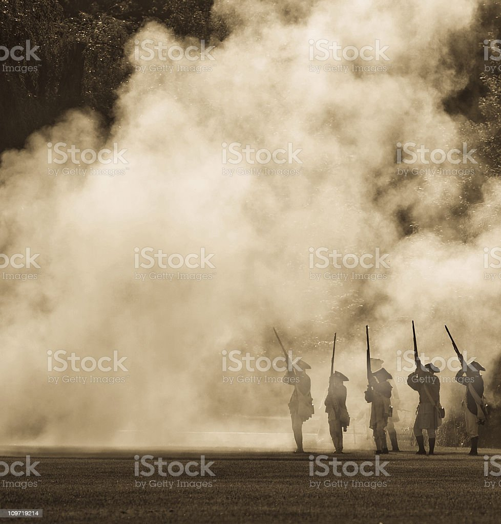 silouettes in cannon smoke stock photo